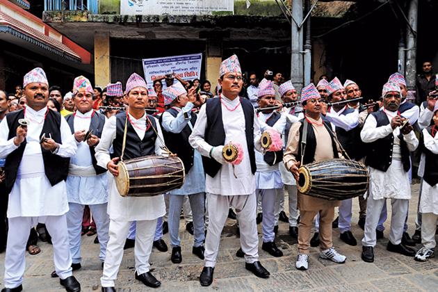Nepal men in traditional costume Daura Suruwal